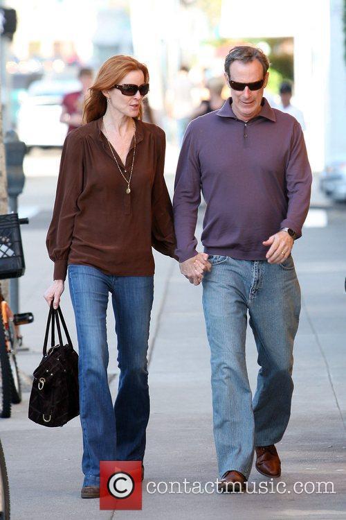 Marcia Cross and husband Tom Mahoney walk back...