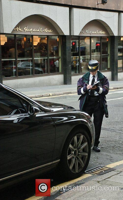 Traffic Warden issuing a parking ticket on Martin...