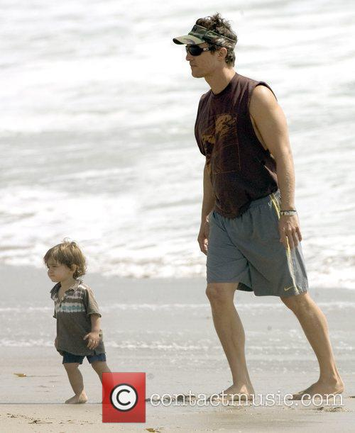 Matthew McConaughey plays with his son, Levi, on...