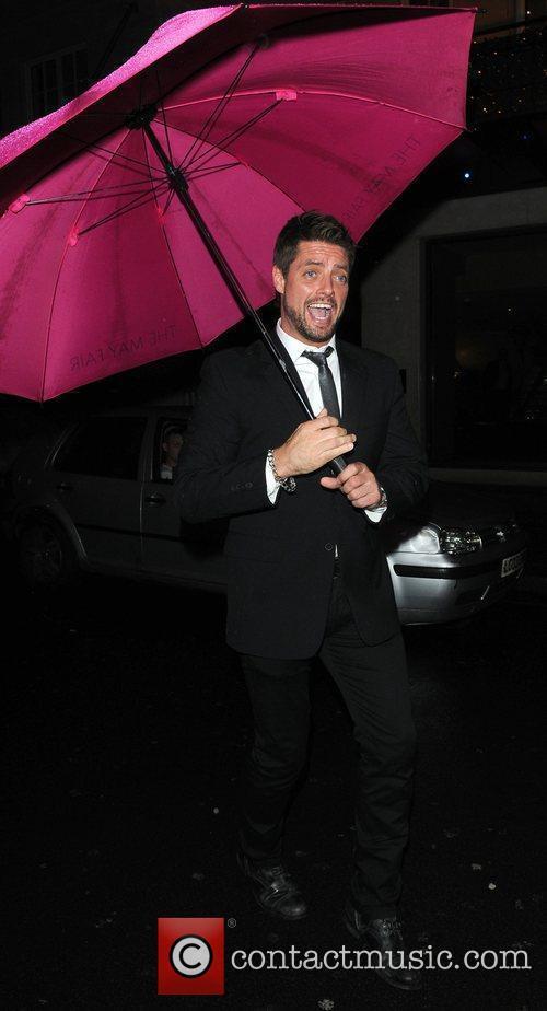 Keith Duffy of Boyzone plays in the rain...