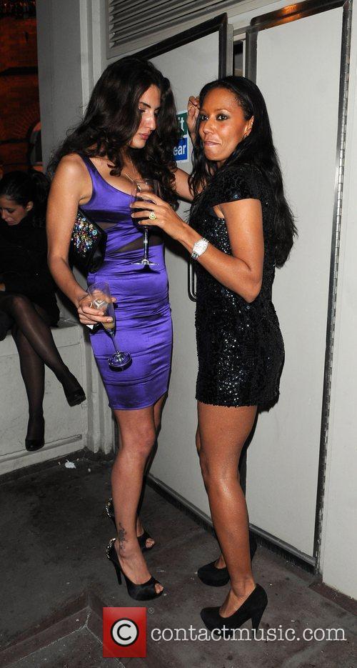 Melanie Brown enjoys a drink with a friend...