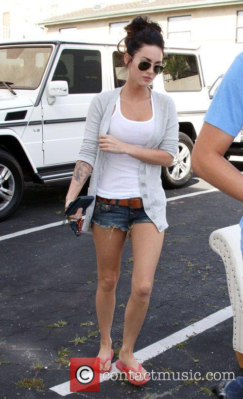 Megan Fox returns to her car after shopping...