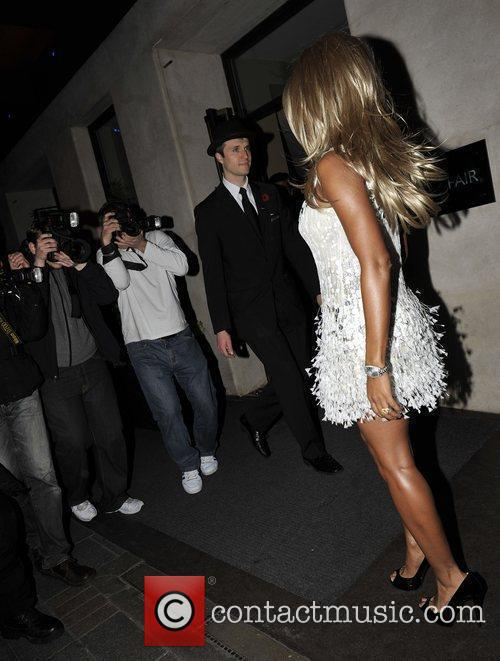 Leaves the May Fair hotel wearing a blonde...