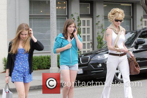 Melanie Griffith and her two daughters, Dakota Johnson...