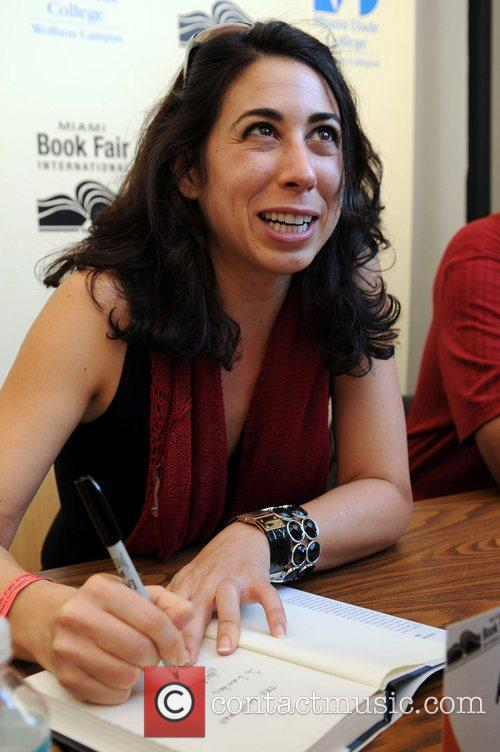 Author Ana Menendez  signing her book 'The...