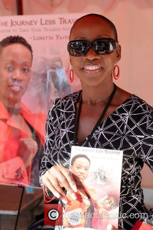 Author Kyus Philnesta  signing her book 'Because...