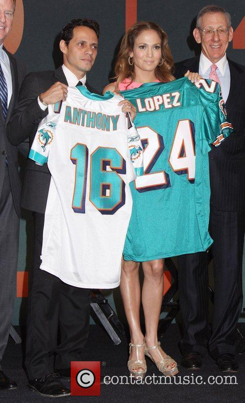 Marc Anthony and Jennifer Lopez attend the NFL,...