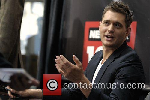 Michael Buble meets his fans and signs copies...