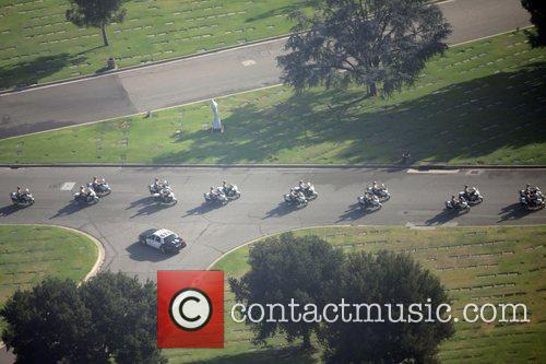 Police Convoy Aerial view of the funeral of...
