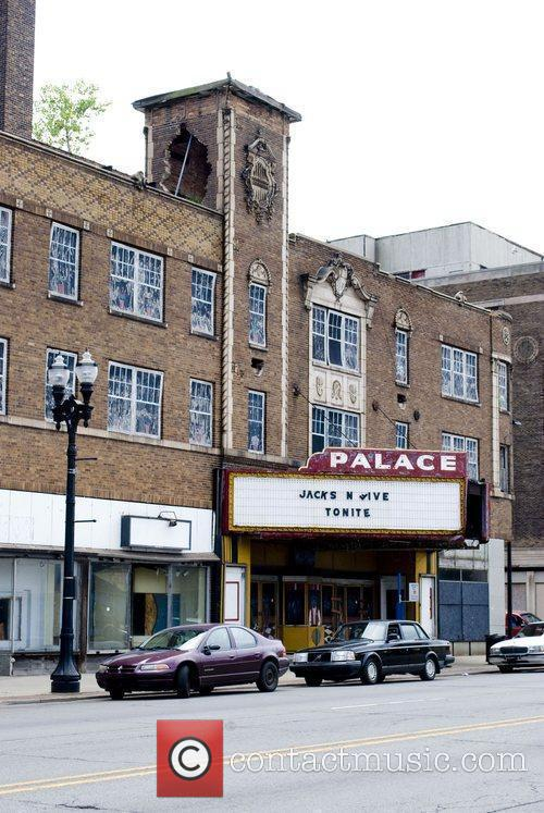 The Palace Theater marquee with a sign reading...