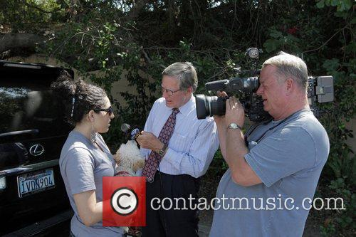 Atmosphere Media crews interview local people outside the...