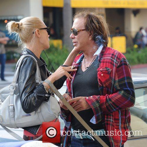 Mickey Rourke shares an intimate moment with a...
