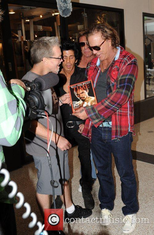 Mickey Rourke is approached by a film crew...