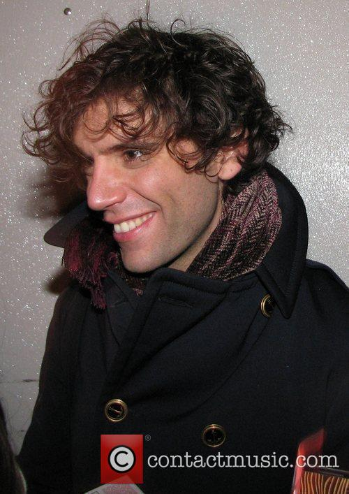 Mika signs autographs for waiting fans after performing...