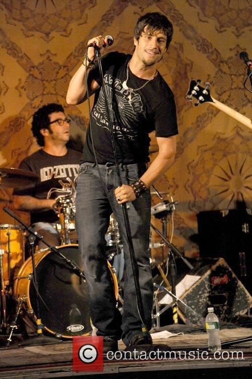 Performing live with his band Apache Stone at...