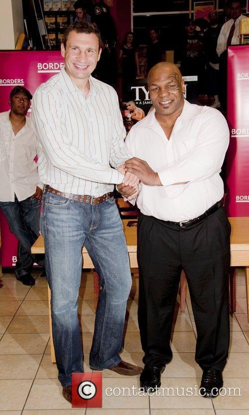Vitali Klitschko, Mike Tyson signing copies of the...