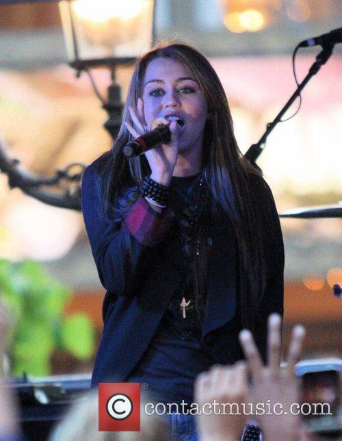 Miley Cyrus performs at Mitchel Musso's free concert...