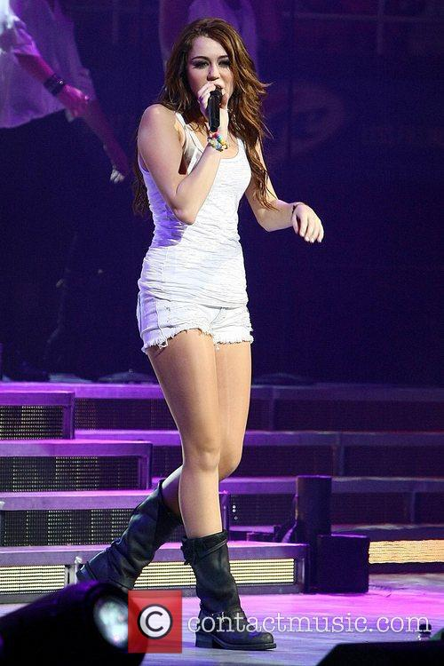 Miley Cyrus performing live in concert at the...