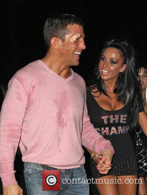 Katie Price and Alex Reid leaving Movida through the back door where they celebrated his cage-fighting victory earlier in the evening. 16