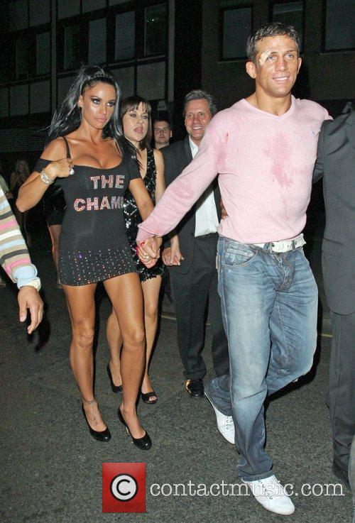 Katie Price and Alex Reid leaving Movida through the back door where they celebrated his cage-fighting victory earlier in the evening. 12