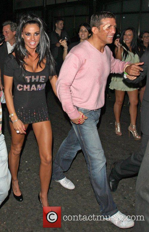 Katie Price and Alex Reid leaving Movida through the back door where they celebrated his cage-fighting victory earlier in the evening. 7