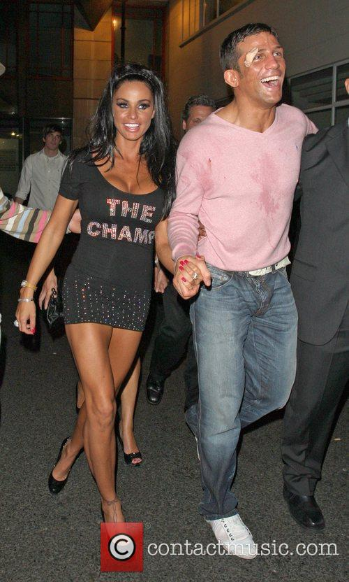 Katie Price and Alex Reid leaving Movida through the back door where they celebrated his cage-fighting victory earlier in the evening. 10