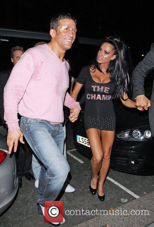 Katie Price and Alex Reid leaving Movida through the back door where they celebrated his cage-fighting victory earlier in the evening. 14