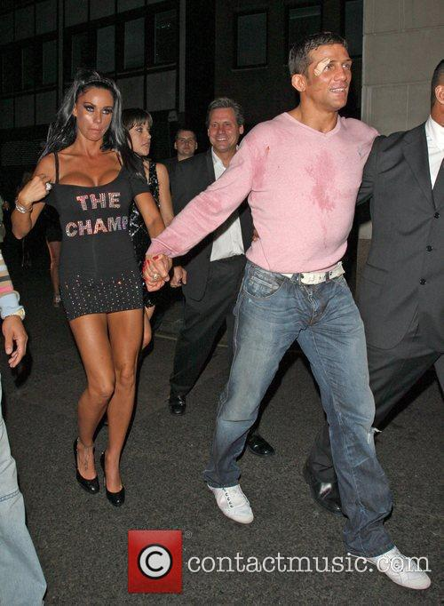 Katie Price and Alex Reid leaving Movida through the back door where they celebrated his cage-fighting victory earlier in the evening. 8