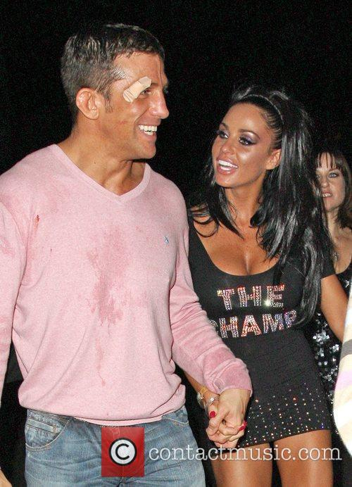 Katie Price and Alex Reid leaving Movida through the back door where they celebrated his cage-fighting victory earlier in the evening. 15