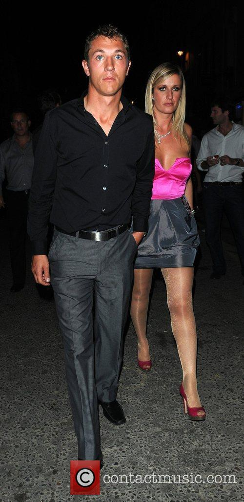 Andrew Gould and his wife leave Movida nightclub...