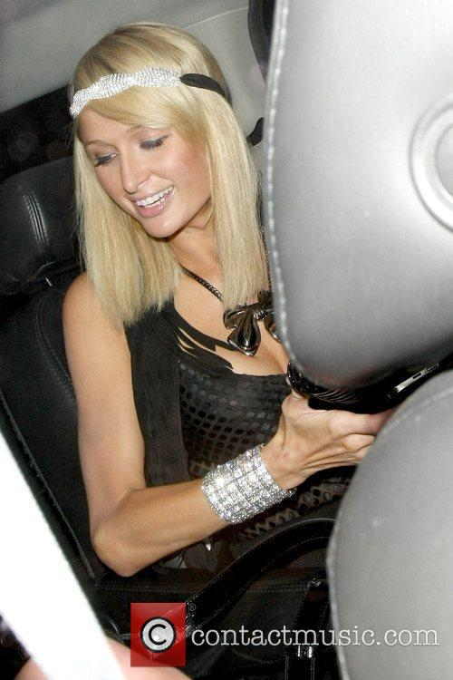 Paris Hilton leaving My House nightclub with her...