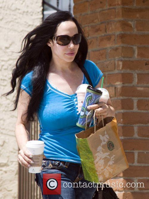 Nadya Suleman Aka Octomom Steps Out With One Of Her 14 Children 8
