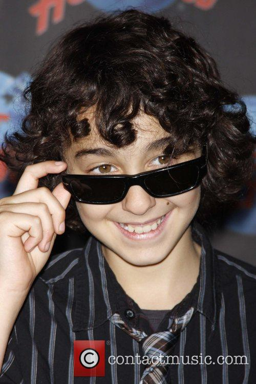 Alex Wolff of The Naked Brothers Band hand...