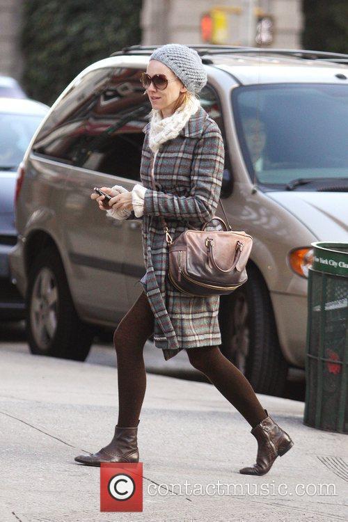 Naomi Watts crosses a street in SoHo while...