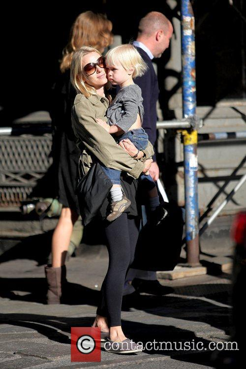 Walking in Soho with her son Alexander 'Sacha'...
