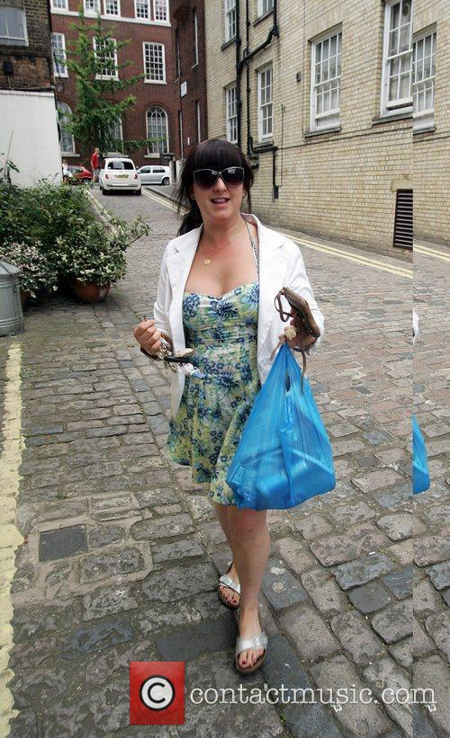 Former 'Eastenders' actress, Natalie Cassidy arrives back home...