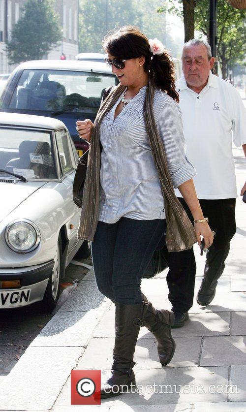 Natalie Cassidy leaving her house with her grandfather