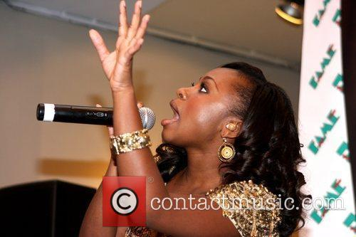 Naturi Naughton, From Fame, Signs Autographs and Performs At The Fame Music Store 3