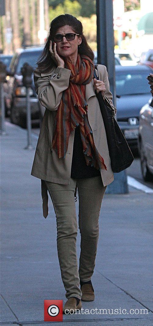 Talks on her cell phone whilst running errands...