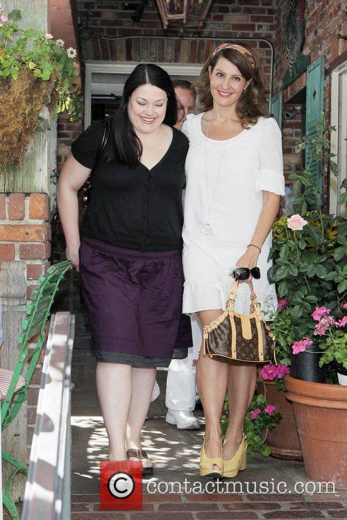 Nia Vardalos and a friend leave the Ivy...