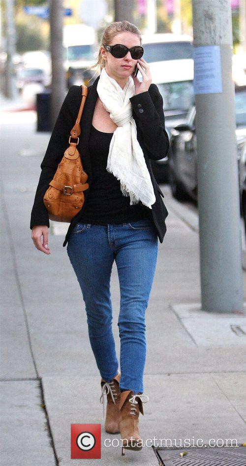 Nicky Hilton talking on her phone as she...