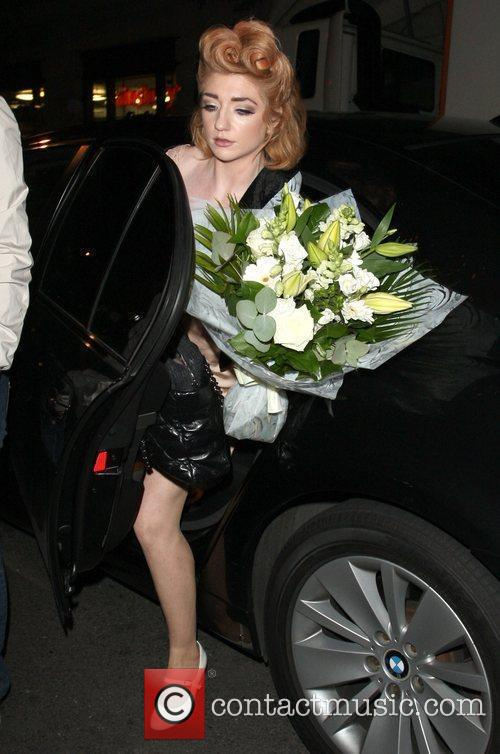 Arrives back at her London hotel after performing...