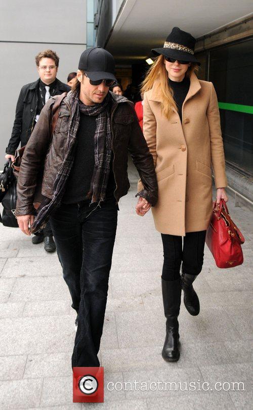 Keith Urban and Nicole Kidman arriving at Heathrow...