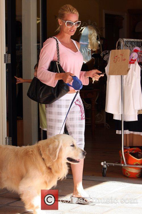 Takes her dog Oscar for a walk in...