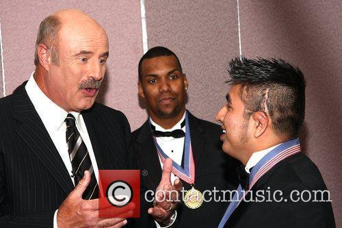 Dr. Phil McGraw, Guest & Marco Robledo attending...