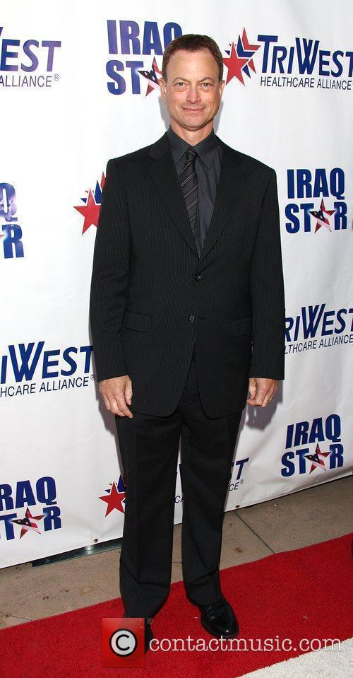 Gary Sinise attending 'A Night of Honour' which...