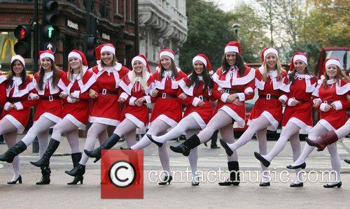 With models dressed as Santa Claus on Oxford...