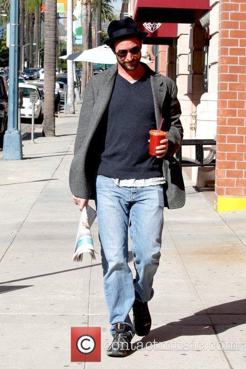 Holding a cold beverage and newspaper while out...