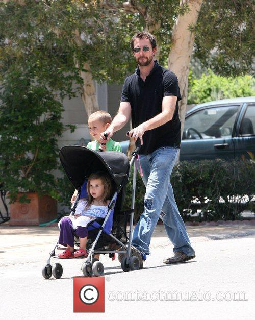 Goes for a stroll with his children
