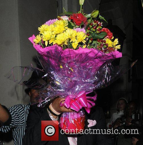 Flowers are carried out of Nobu restaurant following...